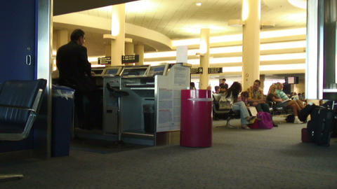 Travelers and employees at an airport terminal Footage