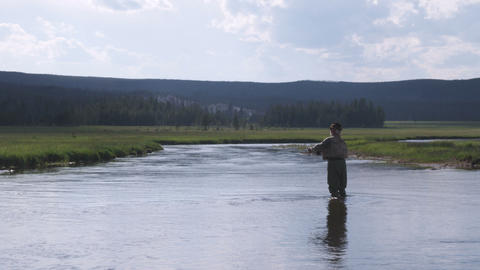 Man fly fishing in a stream Footage