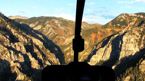 Aerial shot from helicopter cockpit of foliage covered mountains in Utah Footage
