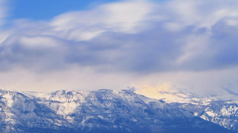 Time-lapse shot of snow-covered mountain peaks in Utah Footage