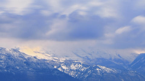 Panning time-lapse shot of snow-covered mountain peaks in Utah Footage