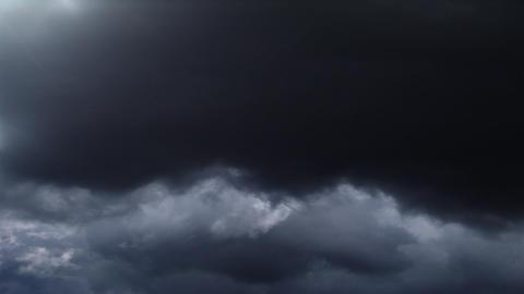 Rolling dark clouds race across the sky Footage