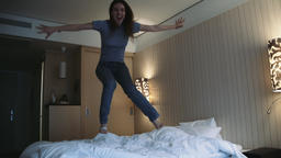 Girl Jumping on Bed in Slow Motion Footage