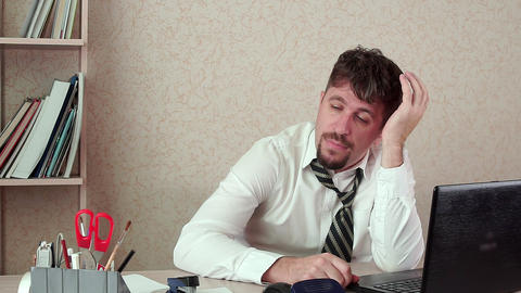Office Manager bearded man, bored, falls asleep at work. He's sitting Live Action
