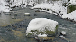 Brook with a boulder at winter time - with audio ビデオ