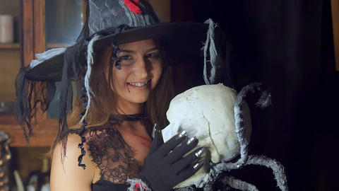 Halloween witch close-up with a staff of a human skull.... Stock Video Footage