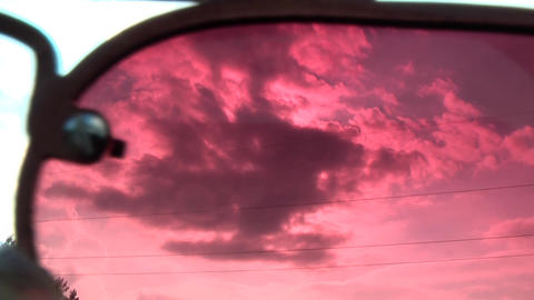 Moving Clouds Through the Red Glasses Footage