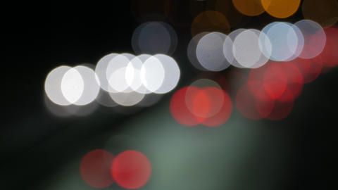 City blur background. Moving bokeh circles of night traffic Footage