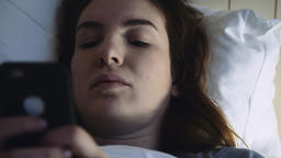 Face of a Young Woman Using Phone in Bed ライブ動画