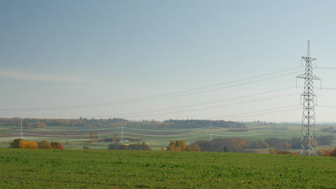 Power lines stretching off into the distance in a rural setting Footage