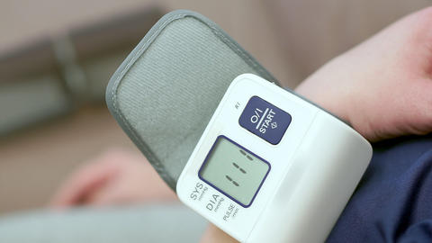 Female hand close-up, includes a tonometer. The display shows Footage