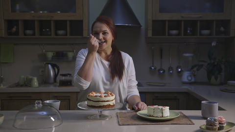 Female confectioner chef cook healthy organic cupcakes and tasting a slice Footage