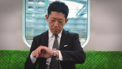 Japanese businessman rising in a train Footage