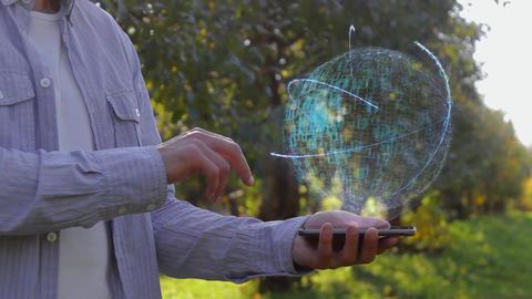 Unrecognizable man shows conceptual hologram with text Develop Live Action