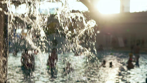 Swimming pool in public aqua park. The sun's rays shine through the fountain of Footage