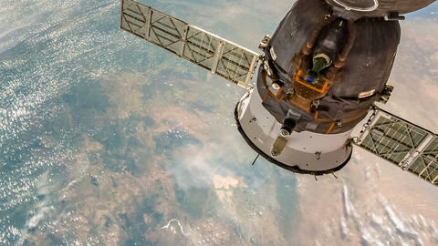 Time lapse of the Space International Station and the earth on the background. Animation