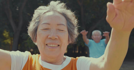 senior couple do exercising in the park Footage