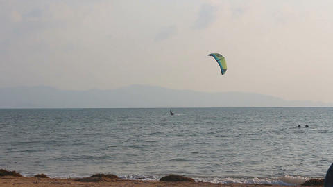 a man practicing kite surfing in the sea ビデオ