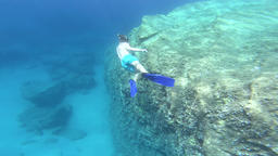 Underwater view of a snorkeler man diving in tropical sea water GIF