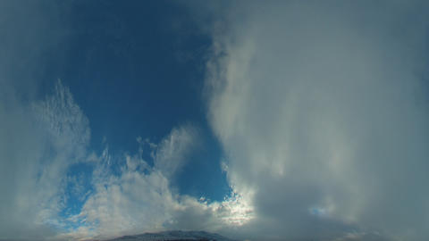 Time-lapse fisheye shot of the clouds and sky on a rainy morning in Utah with le Footage