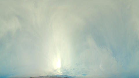 Time-lapse fisheye shot of the sun and sky over Utah with rain spots and lens fl Footage