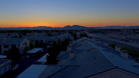 Panning time-lapse shot of Las Vegas sunrise with lens flare Footage