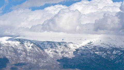 Panning time-lapse shot of snowstorm in the mountains at Utah Footage