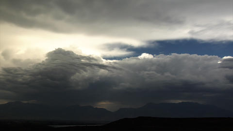 Time-lapse shot of cloudscape over mountains in Utah Footage
