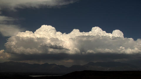 Time-lapse shot of clouds on top of mountains in Utah Footage