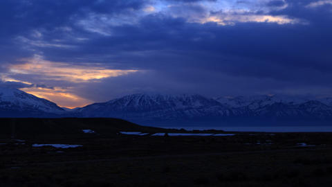 Wide time-lapse shot of the mountain range in Utah during sunset Footage
