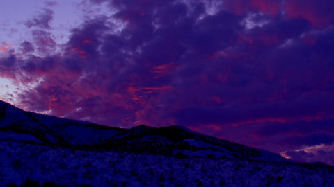 Time-lapse panning shot of mountain and clouds in Utah at sunset Footage