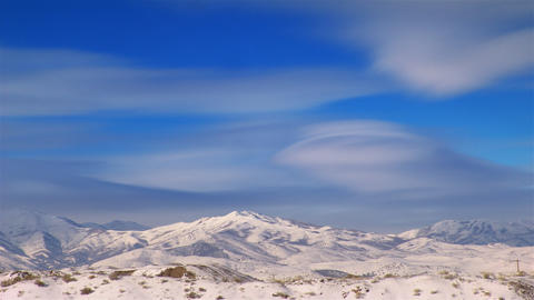 Time-lapse shot of snow-capped mountains in Utah Footage