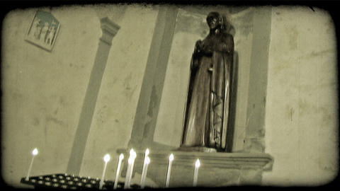 Candles and statue. Vintage stylized video clip Footage