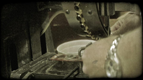 Machine puts holes in tent material. Vintage stylized… Stock Video Footage