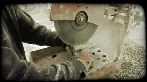 Construction worker cuts bricks. Vintage stylized video clip Footage