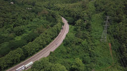 Aerial View Of Countryside Road Passing Through The Mountain Landscape GIF