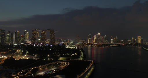 Night flight over the river in Singapore Live Action