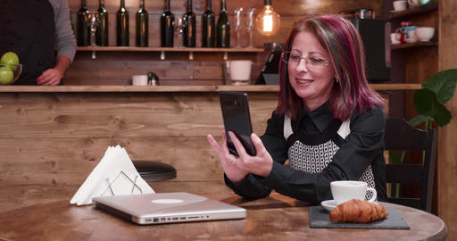 Adult businesswoman having a video call GIF