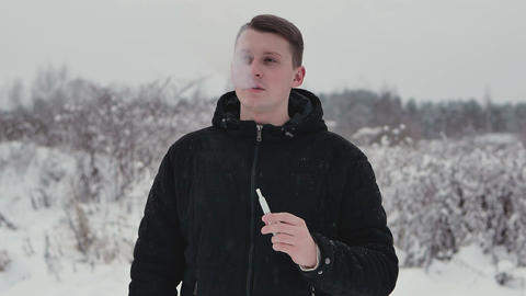 Young man smokes Footage