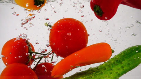 Many fresh vegetables, cucumber, pepper and tomatoes... Stock Video Footage
