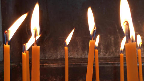 Flame of Burning Wax Candles Waving in the Wind Footage