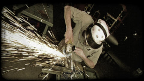 Man splices metal with a machine. Vintage stylized video clip Live Action