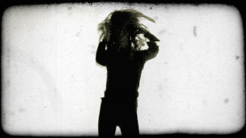 Silhouette of a young woman dancing. Vintage stylized video clip Footage