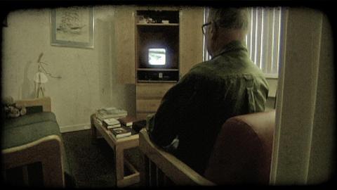 Elderly man watches tv. Vintage stylized video clip Footage