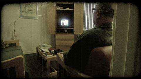 Elderly man watches tv. Vintage stylized video clip Stock Video Footage