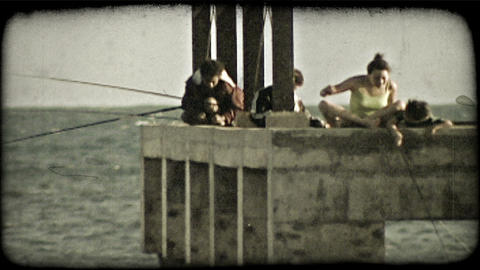 People fishing off of dock. Vintage stylized video clip Footage