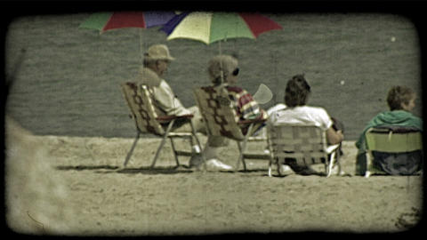 People sit at lake front. Vintage stylized video clip Footage