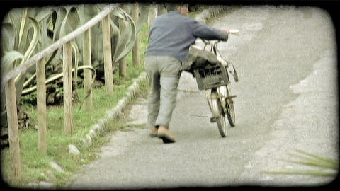 Man and Bike. Vintage stylized video clip Footage