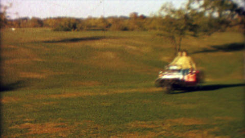 1965: Pre-teen girl practice driving car with golf cart around course Footage