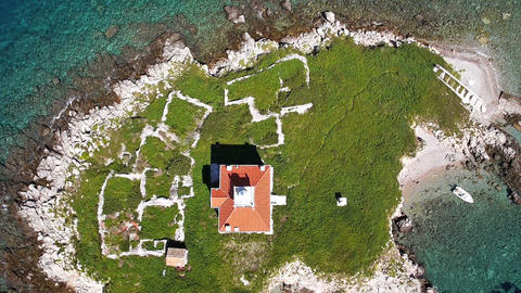Aerial, vertical - Lighthouse building on a small island Footage